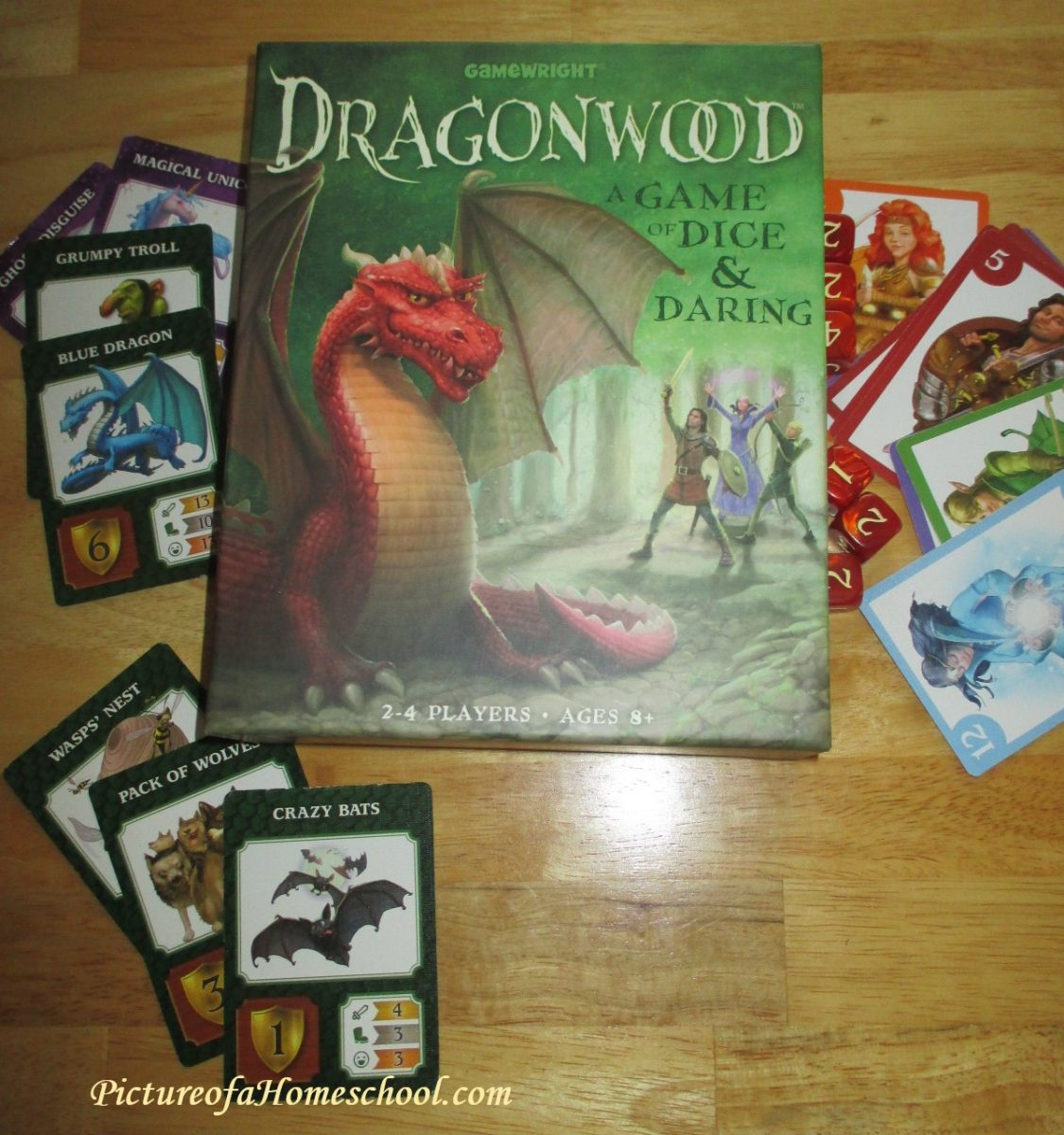 dragonwood card and dice game with dragons and mythical creatures