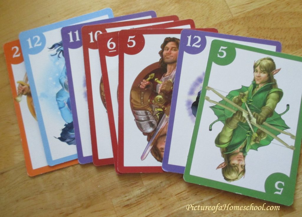 dragonwood card and dice game with dragons and mythical creatures card spread